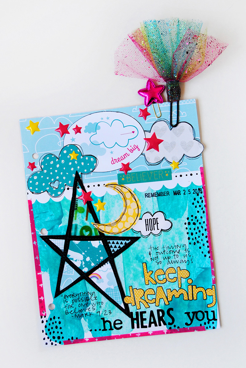 Elaine is sharing with us about dreaming big with God and her mixed media art journal page in her Illustrated Faith Praise Book
