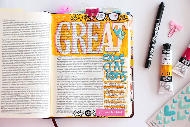 Natalie shares a process video showing some fun techniques such as how to get a giant title into your journaling bible, as well as a masking and painting tip to create colourful journaling lines