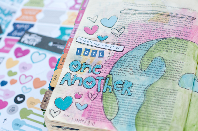 mixed media art journaling Bible page and message of how God calls us to love beyond our religion, beyond the borders of our country, beyond our comfort zone | Jess Robyn